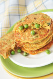 Pea flour fritters with green peas and carrots Stock Photography