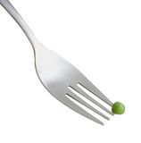 Pea on fork Stock Image