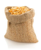 Pea grain in sack bag on white Stock Photography