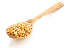 Pea grain and wooden spoon. On white stock image