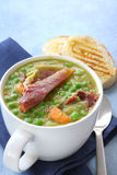 Pea and Ham Soup. With crusty toasted sourdough bread.  Topped with crispy prosciutto Stock Images