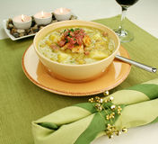 Pea And Ham Soup. Chunky pea and ham soup with croutons and ham with a parsley garnish Stock Photos
