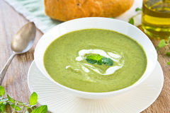 Pea,Mint and Celery soup. In a bowl by Bacon bread Royalty Free Stock Image