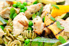 Pea pesto pasta with chicken Stock Image