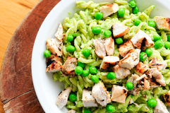 Pea pesto pasta with chicken Royalty Free Stock Photography