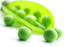 Pea pod and peas Stock Photos