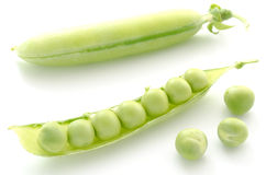 Pea pods and peas Stock Images