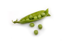 Pea pods on a white background. Green peas in pods on a white background to highlight Stock Photos