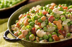 Pea Salad. A bowl of freshly made pea salad with green peas, chick peas, cashews, green onion, bacon, celery, and creamy ranch dressing stock photography