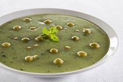 Pea soup. Fresh green pea soup close up shoot Stock Image