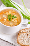 Pea soup. With bread and green onion Stock Photo