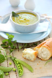 Pea Soup. Delicious pea soup with fresh mint and crusty bread Stock Images