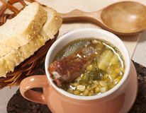 Pea soup. With smoked ribs and bread Stock Images