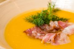 Pea soup with bacon on a wooden table royalty free stock photo