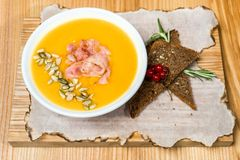 Pea soup with bacon on a wooden table royalty free stock image