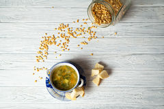 Pea soup. With baked breads Royalty Free Stock Photography