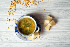 Pea soup. With baked breads Stock Photography