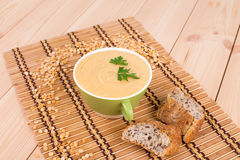 Pea soup in a bowl with bread. Stock Photography