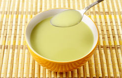 Pea soup in a bowl with a spoon Royalty Free Stock Image