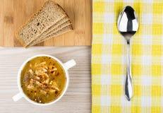 Pea soup, bread and spoon Stock Photos