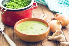 Pea soup in ceramic bowl Stock Photo