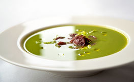 Pea soup with chorizo sausage Stock Photography