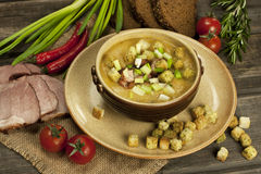 Pea soup with croutons Stock Photo
