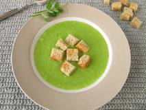 Pea soup with croutons Stock Photos
