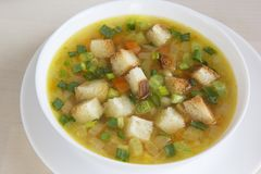 Pea soup with croutons Royalty Free Stock Images