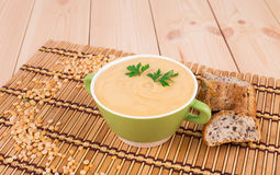 Pea soup in a green bowl with parsley. Royalty Free Stock Photo
