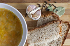 Pea soup. With herbs and bread with sesame seeds Royalty Free Stock Photos