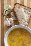 Pea soup. With herbs and bread with sesame seeds Royalty Free Stock Photo