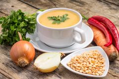 Pea soup with ingredients on wood background Stock Photography