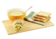 Pea soup with a jar of peas Stock Photography