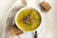 Pea soup with meat. Fresh pea soup with meat in white bowl Stock Photos