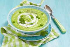 Pea soup with mint and fried bread stock image