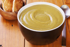 Pea Soup on an Old Wooden Table Stock Image