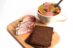 Pea soup, pumpernickel and bacon Stock Images