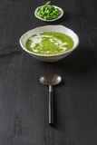 Pea soup puree with cream and olive oil in an old white bowl, pa Royalty Free Stock Image