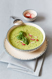 Pea soup with red radish Stock Images