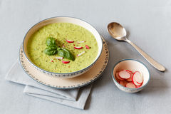 Pea soup with red radish Stock Photos