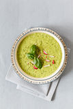 Pea soup with red radish Stock Image