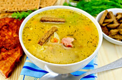 Soup pea with croutons and bacon Stock Photo