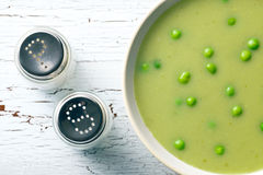 Pea soup and salt shaker Stock Photography
