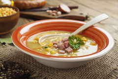 Pea soup with sausage royalty free stock image