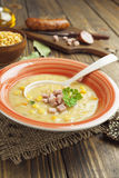 Pea soup with sausage royalty free stock photo