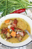 Pea soup with smoked meat Stock Photography