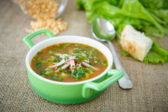 Pea soup with smoked meat Stock Image
