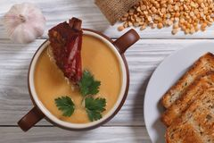 Pea soup with smoked meat Royalty Free Stock Photography