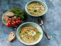 Pea soup with smoked meat, vegetables and greens. Delicious and healthy homemade food stock photos